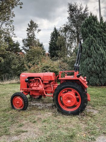 Plant Tree Transportation Agricultural Equipment Red Tractor Nature Land Field Cloud - Sky Agricultural Machinery No People Agriculture Outdoors Day Land Vehicle Mode Of Transportation Sky Growth Sunlight