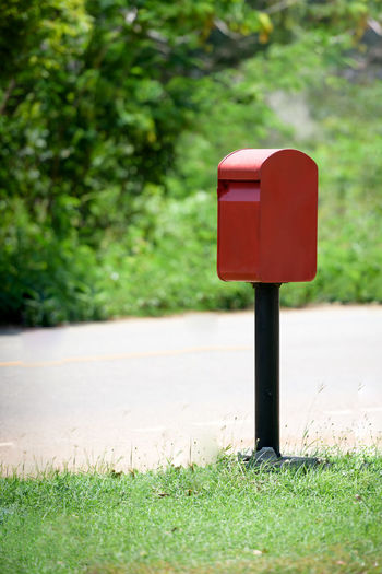 Red mailbox on roadside