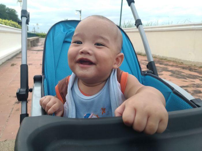 Portrait of cute boy in stroller
