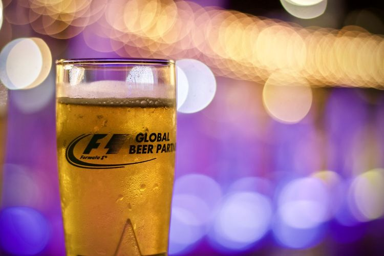 Drink Refreshment Close-up Food And Drink Focus On Foreground Illuminated Communication Text Alcohol Beer No People Western Script Glass Beer - Alcohol Indoors  Drinking Glass Yellow Beer Glass Transparent Glass - Material Purple
