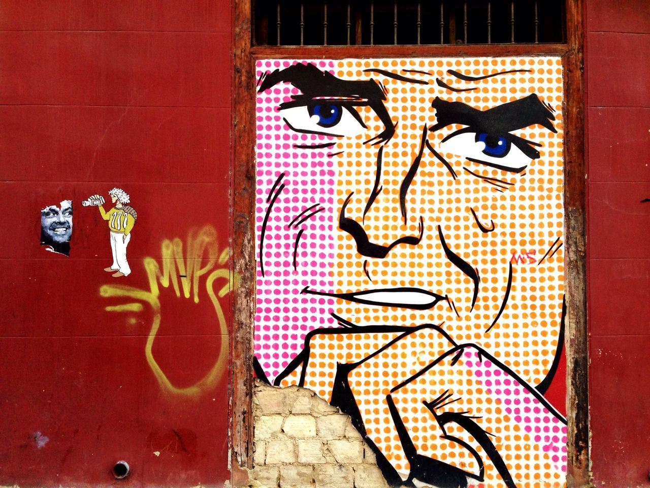 graffiti, art and craft, creativity, wall - building feature, built structure, architecture, human representation, street art, building exterior, outdoors, no people, day, window, communication, close-up