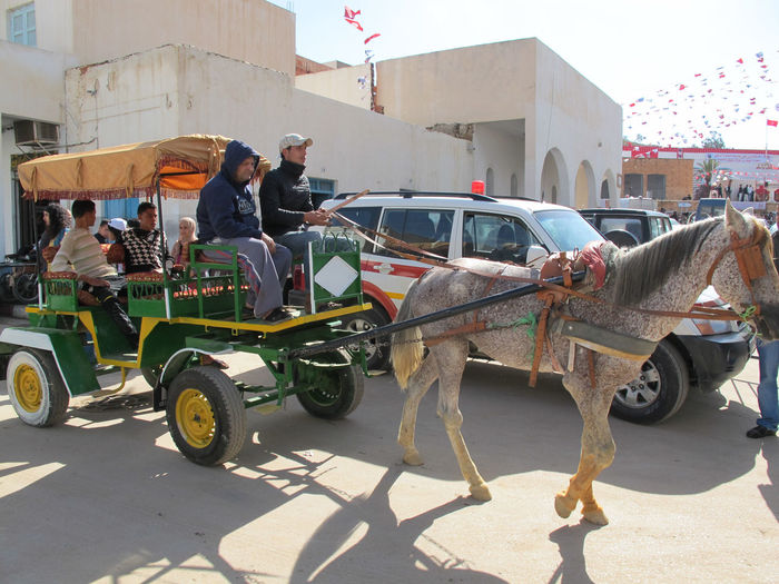 Tunisia travel holidays Transportation Architecture City Mode Of Transportation Real People Men Building Exterior Sunlight Group Of People Street Day Built Structure Land Vehicle Incidental People People Shadow Road Nature Motor Vehicle Car Outdoors