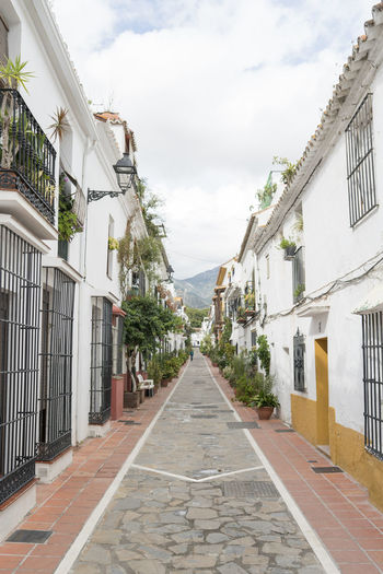 Marbella MarbellaOldTown Old Town SPAIN Architecture Spanish Architecture Holiday Destination Vibrant Color Built Structure Building Exterior The Way Forward Direction Building Sky Nature Diminishing Perspective Day Residential District No People Road Plant House Footpath Long Alley