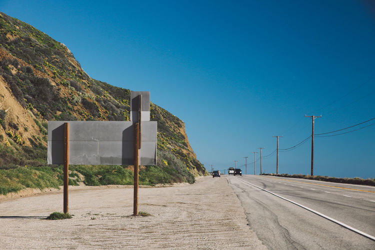 California Coastline Pacific Pacific Coast Highway Road Blue Clear Sky Coast Day Mountain Mountain Range Nature No People Outdoors Road Sky Sunlight The Way Forward Transportation California Dreamin Summer Road Tripping Stay Out
