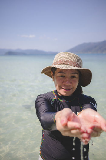 Portrait of a smiling young woman in sea