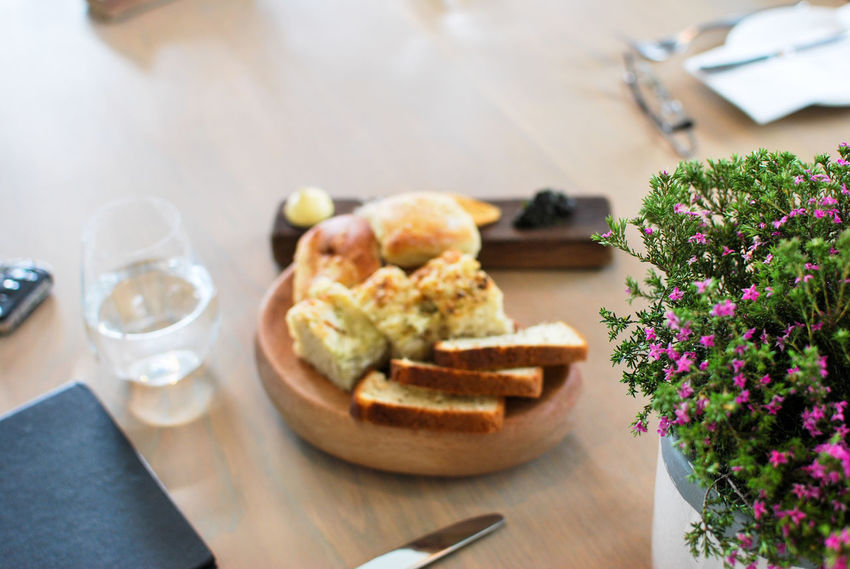 Bread Close-up Drink Drinking Glass Flower Flower Head Flowering Plant Focus On Foreground Food Food And Drink Freshness Glass Healthy Eating Household Equipment Meal Nature No People Plant Refreshment Setting Snack Table Wellbeing