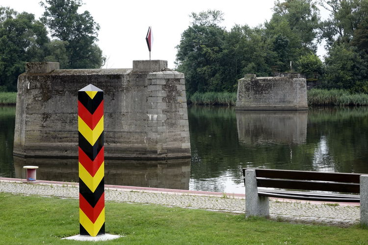 Oder River Pylon Architecture Border Borderstone Bridge Bridge Pier Built Structure Day Flag Grass Green Color Growth Lake Nature No People Outdoors Sky Tree Water