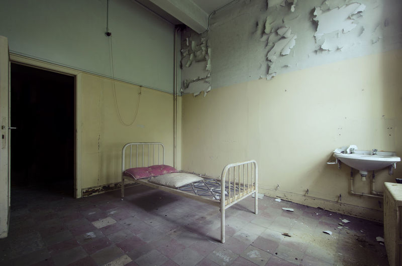 Empty Bed In Abandoned Prison Cell