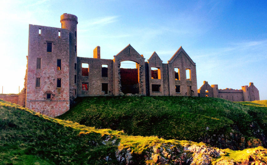 Slains Castle where Bram Stoker found inspiration for Dracula. Aberdeenshire Architecture Building Exterior Built Structure Castle Cruden Bay Damaged Dracula Exterior Famous Place History No People Slains Castle Sunset Tourism Travel Destinations