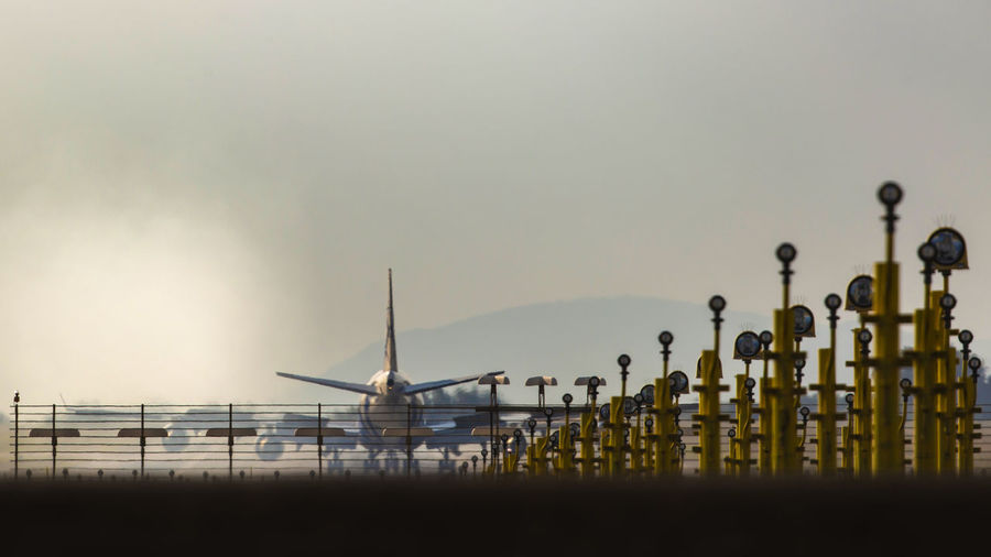 [Canon EF 300mm f/2.8 L IS II USM] Plane Air Vehicle Airplane Airport Airport Runway Beauty In Nature Fuel And Power Generation In A Row Industry Mode Of Transportation Nature No People Outdoors Sky Transportation Travel