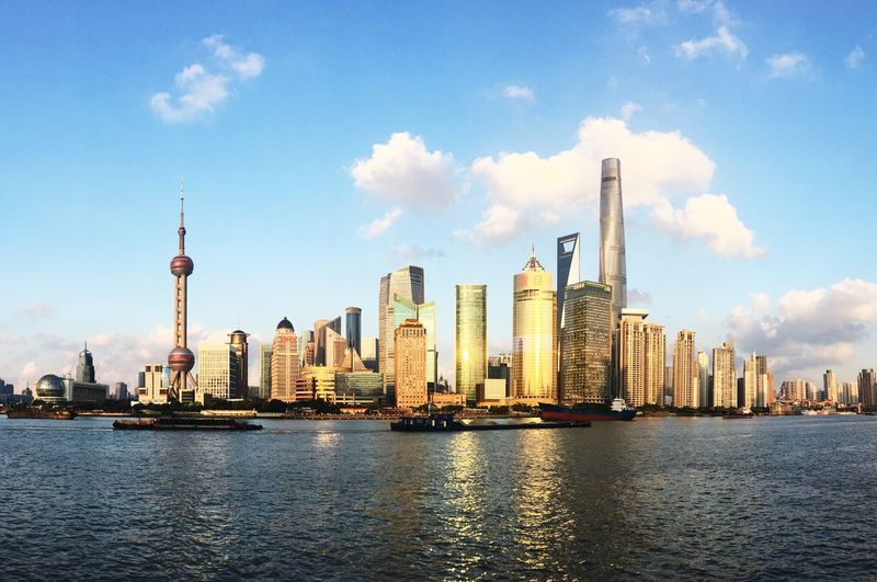 VSCO Shanghai Waitan The Bund Shanghai The Bund Bund Golden Sunrays Nice Weather Evening Sky Autumn Sky Golden Sunset Architecture Built Structure Building Exterior Sky Office Building Exterior Building City Skyscraper Tower Cloud - Sky Modern Travel Destinations Cityscape Landscape Urban Skyline River First Eyeem Photo Adventures In The City