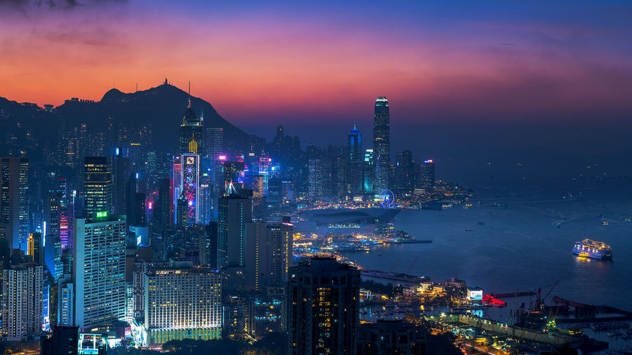 Illuminated View Of Hong Kong Against Sky At Sunset