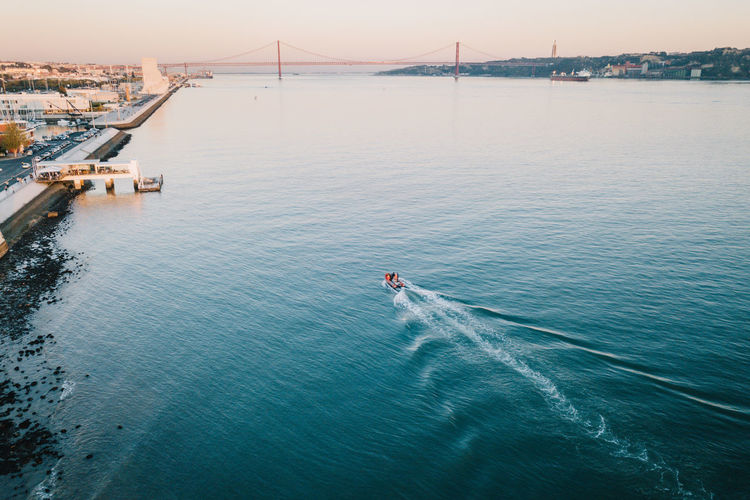 People Sea Water Nature Real People Men Sky Travel Tourism Day Outdoors Lisboa Transportation Lisbon Belém Drone  Belem Tower Scenics Wake Torre De Belém Beauty In Nature Lissabon Mode Of Transport Drohne Luftaufnahme Dronephotography High Angle View One Person Travel Destinations Nautical Vessel Bridge - Man Made Structure Droneshot