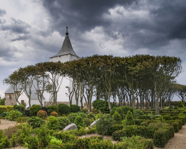 Old church in Denmark. Architecture Cemetery Chapel Church Denmark Historical Building Path Plants Stormy Weather Trees Building Clouds Day Garden Graves Religion Tower Travel Destinations