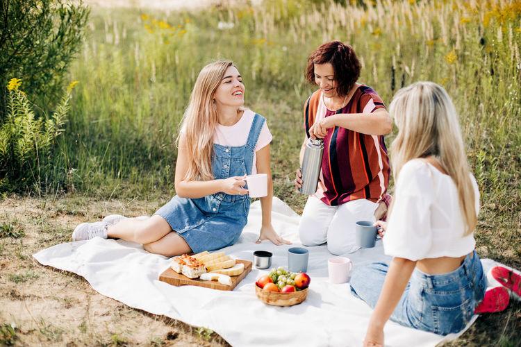 Women sitting on a field
