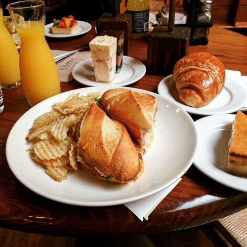 Sandwich in cafe Food Healthy Eating Freshness Orange Juice  Food And Drink Sandwich Breakfast Lunch Cafe French Dessert Drinking Glass Temptation Drink Bread First Eyeem Photo