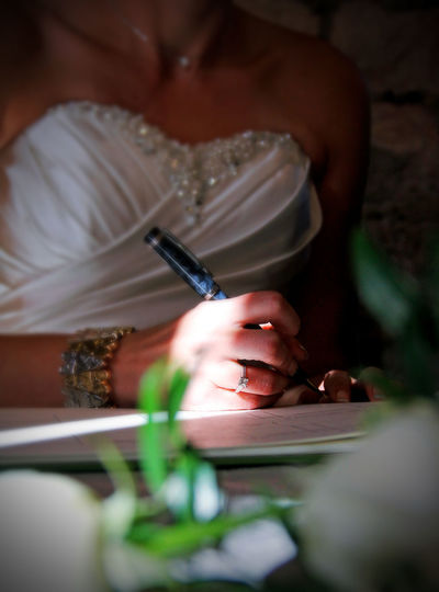 Bride Ceremony Close-up Day Holding Human Hand Indoors  Marriage  One Person Pen People Real People Register Signing Wedding