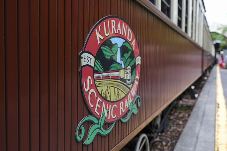 Kuranda Scenic Railway Kuranda Scenic Railway Logo Design Sign Station Car Carriage Focus On Foreground No People Outdoors Pattern Rail Track Railroad Railway Representation Scenic Railway Script Sign Station Platform Text Train - Vehicle Train Station Transportation Wagon Train