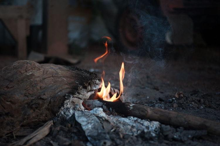 Close-up of bonfire on rock
