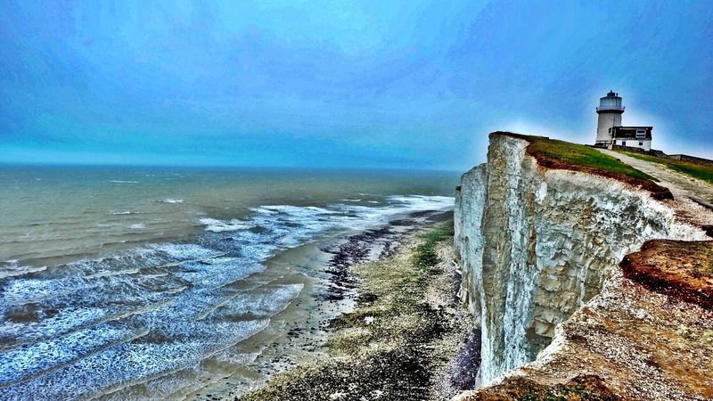 Sea Sky Nature Building Exterior Architecture Lighthouse Outdoors Built Structure Beauty In Nature Water Scenics Horizon Over Water Beach No People Day Hdr_Collection Seven Sisters Cliffs @BestPhotos Seven Sisters @getbetterwithalex @PeterPossum @JeffWoytovich @WINEANDMORE @Uniquephotoarts Beauty In Nature Your Ticket To Europe