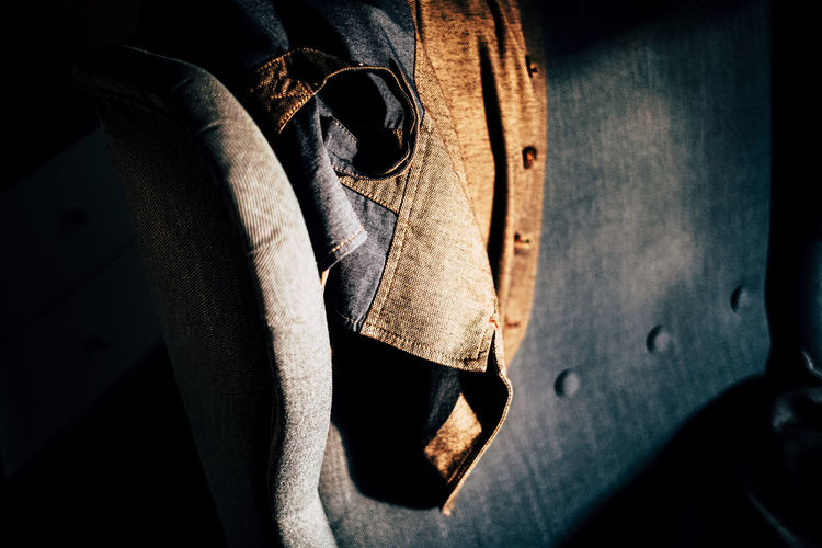 High angle view of waistcoat hanging on chair