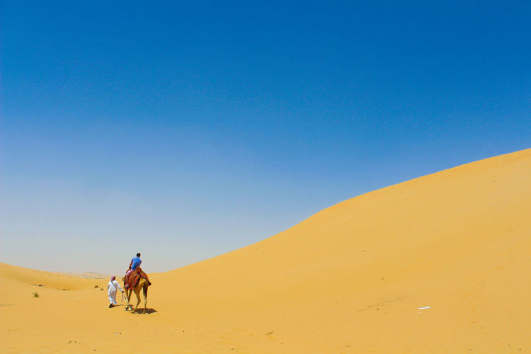 Desert Riding EyeEmNewHere Best EyeEm Shot Full Length Sand Outdoors Sand Dune Deserts Around The World Desert Abu Dhabi Young Adult Happiness Fun Loving Life  Vacations Scenics EyeEm NatureLover Landscape Travel Destinations Real People Cultures Lifestyle Travel