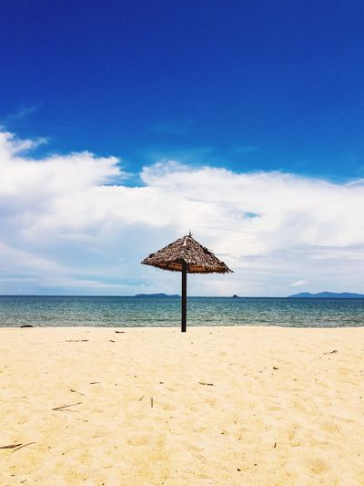 Sunny day Hot Day Summer Sunny Day EyeEm Selects Beach Sky Land Sea Water Sand Horizon Over Water Horizon Beauty In Nature Cloud - Sky Tranquility Beach Umbrella Shade
