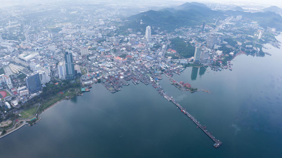 Aerial view of buildings by sea in city