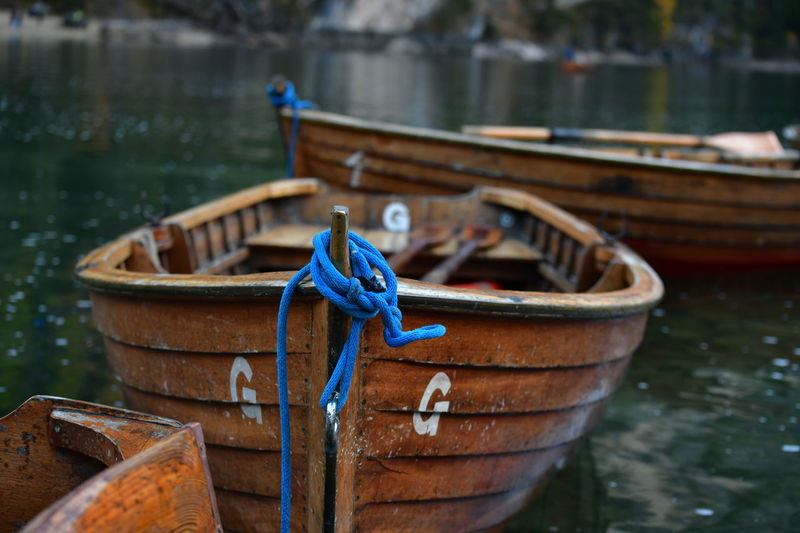 Blue tied up on boat moored in lake