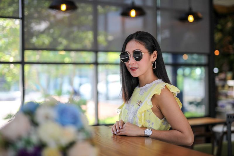 Woman in yellow dress Smiling Looking At Camera Happiness Portrait Sunglasses Women Beauty Beautiful Woman Emotion Fashion One Person Glasses