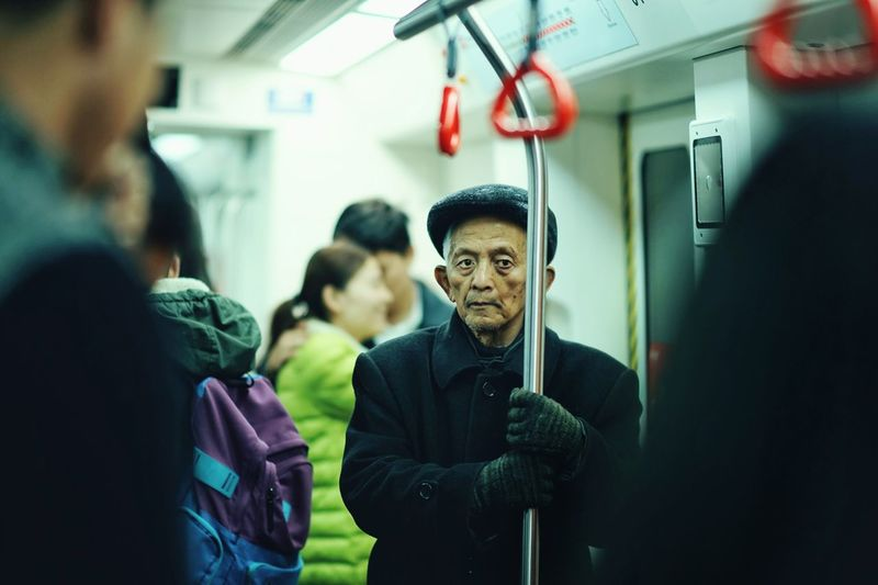 Portrait Of Mature Man Standing In Train