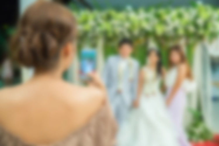 Adult Day Defocused Event Females Group Of People Hair Hairstyle Headshot Leisure Activity Lifestyles Men People Portrait Real People Rear View Selective Focus Standing Togetherness Wedding Women