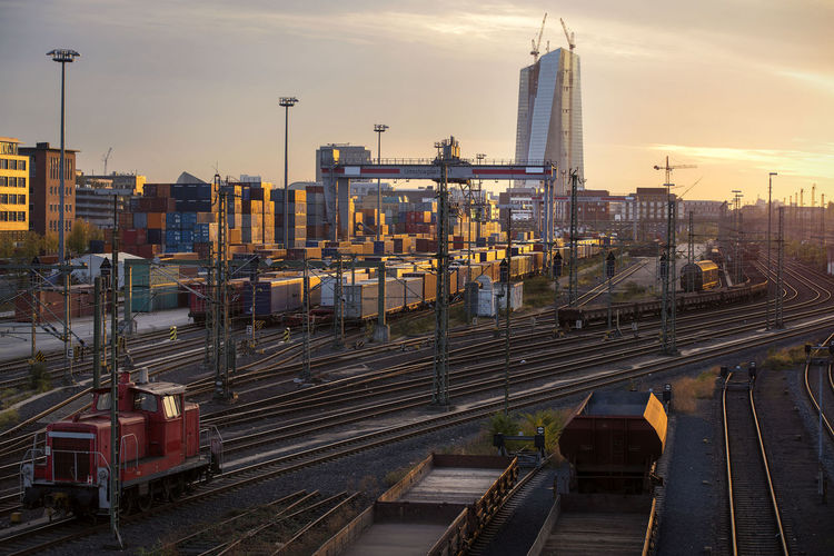 Frankfurt panorama from railway at sunset Rail Transportation Transportation Track Railroad Track Train High Angle View Sky Architecture Built Structure Sunset No People Mode Of Transportation Building Exterior Skyscraper Panorama Industry Train - Vehicle Public Transportation City Twilight Sky