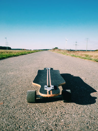 High Angle View Of Longboard On Road Against Sky