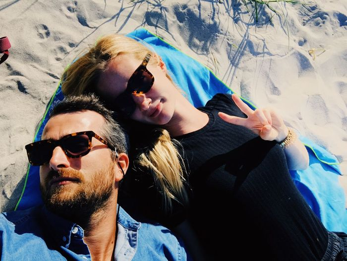 Enjoying the sun at the beautiful Prerow beach. Sunglasses Togetherness Leisure Activity Two People Vacations Fun Happiness Lifestyles Couple - Relationship Real People Smiling Love Portrait Outdoors Men Young Adult Day Bonding Summer Selfie