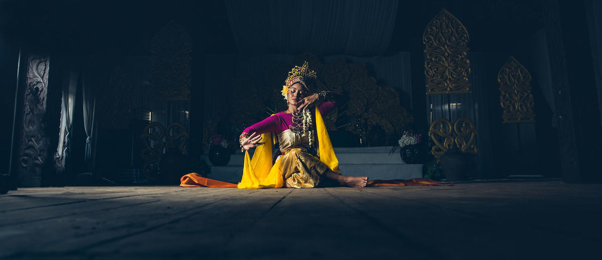 Woman in traditional clothing sitting on floor