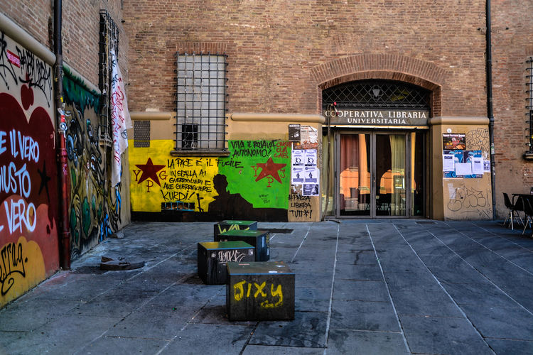 Bologna Colours Freedom Graffiti Thinking Wall Writings Architecture Building Exterior Built Structure City Communication Day Ideas No People Outdoors People Store Street Streetart Streetphotography Text University Wild Young People
