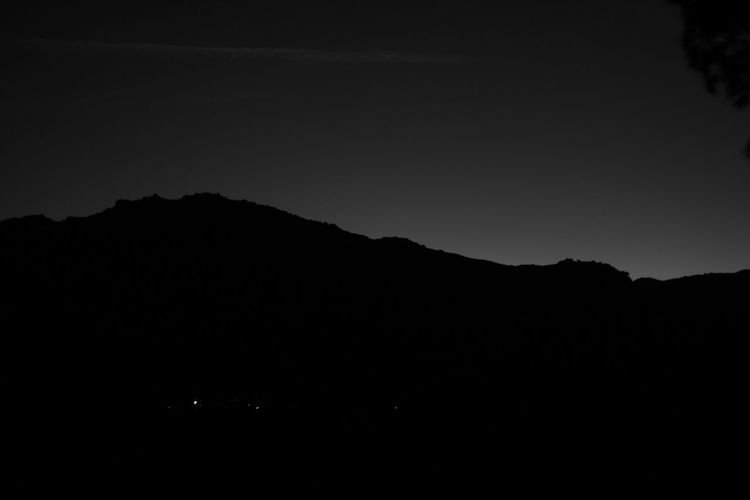 Silhouette mountain against clear sky