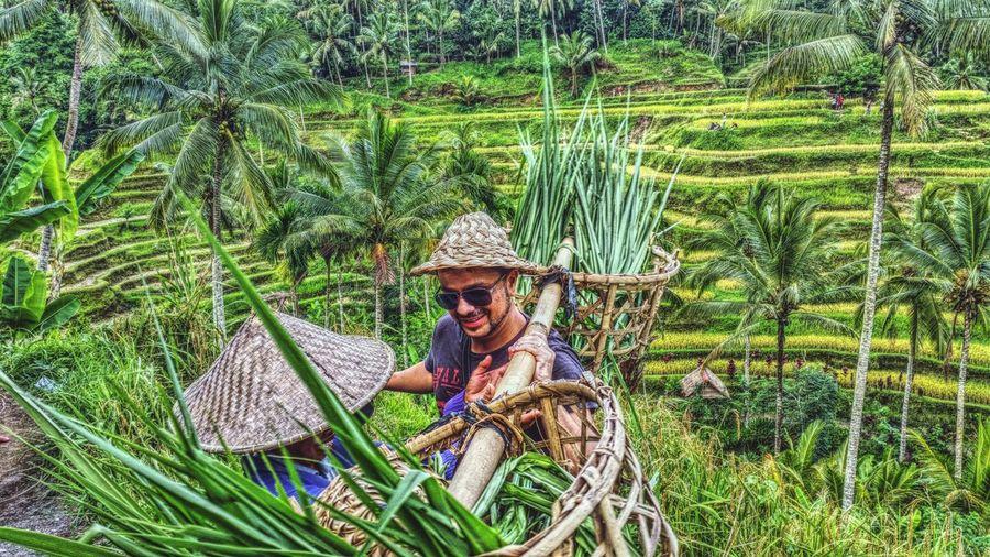 Man holding basket in farm