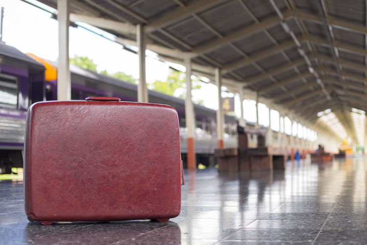Close-Up Of Suitcase On Railroad Station