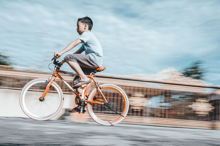 Motion Blur Bicycle Casual Clothing Day Full Length Leisure Activity Lifestyles Mode Of Transportation Motion Motion Capture Nature One Person Outdoors Real People Ride Riding Sport Transportation Water Young Adult Young Men Summer In The City Summer In The City