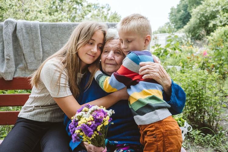Reunited, family, togetherness, relationships, meeting, embracing. kids visit grandmother