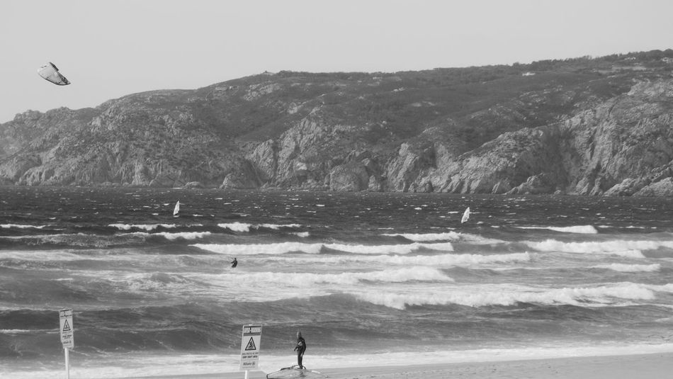 A great beach for surfing and kite surfing and wind surfing, summarizing for water sports At Praia Do Guincho Black And White Blackandwhite Cascais, Guincho EyeEm Nature Lover Flying Seagull Kitesurfing Surf Taking Photos Wind Surfing