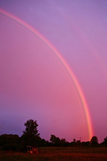 Scenic view of rainbow against sky during sunset