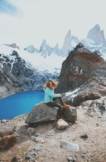 Mountain Rock Solid Rock - Object Leisure Activity One Person Mountain Range Sitting Beauty In Nature Scenics - Nature Lifestyles Real People Sky Nature Full Length Day Tranquility Relaxation Non-urban Scene Outdoors Snowcapped Mountain Mountain Peak Formation