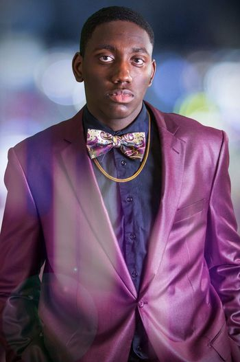 Prom season Portrait Adult One Person Men Front View Looking At Camera Lifestyles Menswear Clothing Waist Up Purple Mid Adult Pink Color Indoors  Well-dressed Jewelry Business Real People Fashion