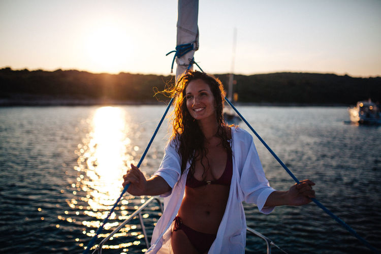 On a boat - Croatia Croatia TeamCanon Adult Beautiful Woman Bikini Front View Happiness Holding Leisure Activity Lifestyles Looking At Camera Nature Nautical Vessel One Person Portrait Sailboat Sea Sky Smiling Sunlight Sunset Transportation Water Women Young Adult