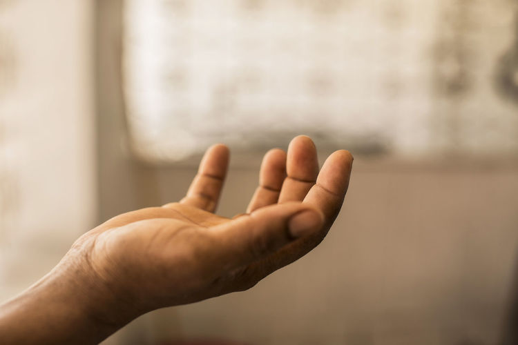 Cropped image of person hand holding invisible product