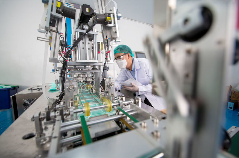 Portrait of worker working in factory