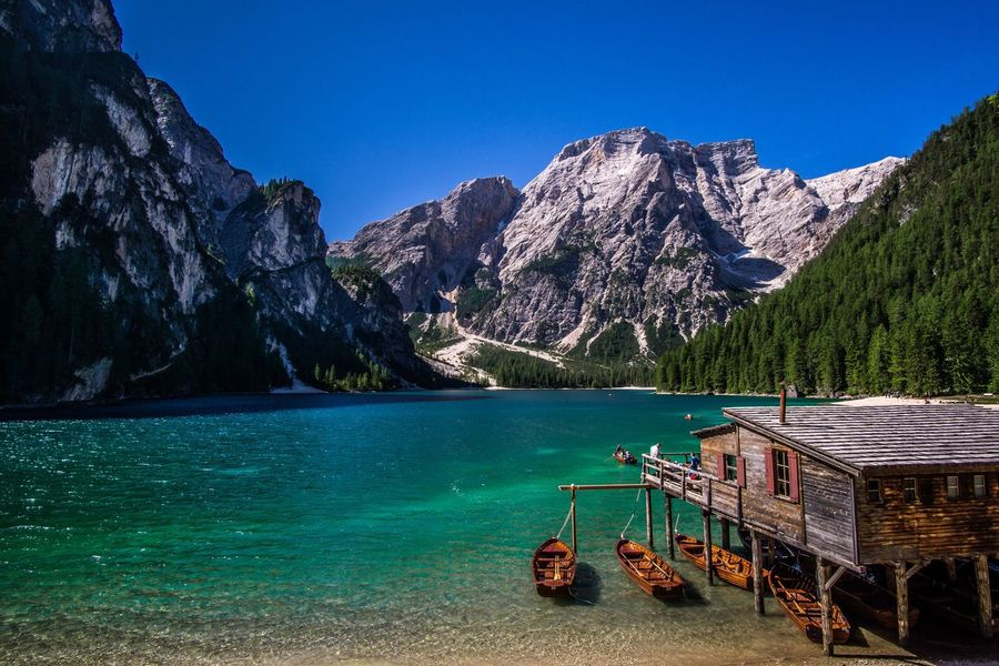 Mountain Beauty In Nature Water Blue Scenics Nature Clear Sky Rock - Object Nautical Vessel Lake Day Outdoors Mountain Range Tranquility No People Travel Destinations Sky Tree Lago Di Braies Pragserwildsee